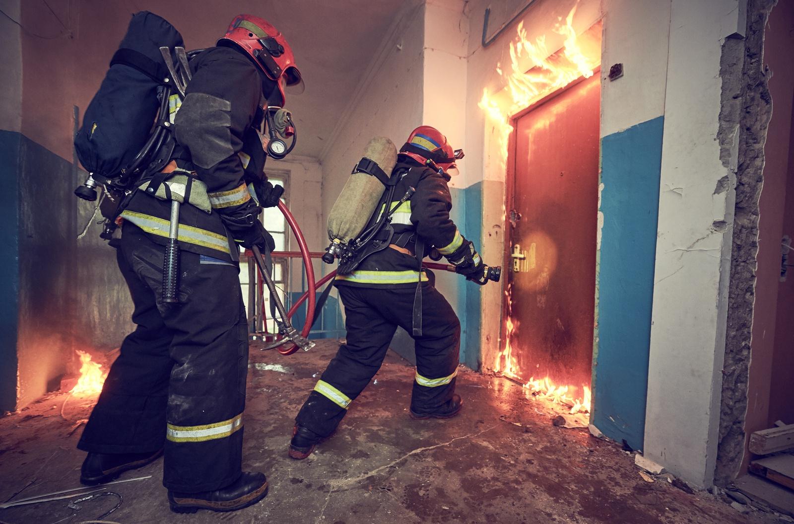 bigstock-Firemans-team-during-firefight-200543074.jpg