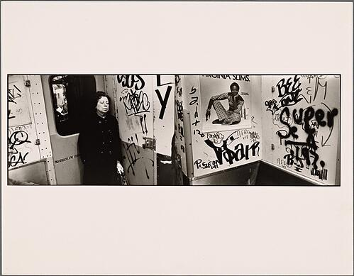 """""""Woman with Eyes Closed and White Gloves by Emergency Door: Graffiti"""" The New York Public Library Digital Collections. 1977 - 1979"""